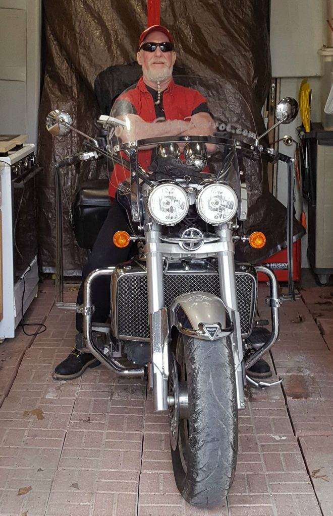 Mitch on Triumph Rocket 3 in shed